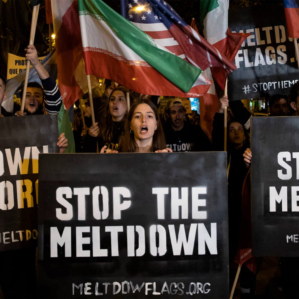 protest pictures, women holding a sign 'stop the meltdown'