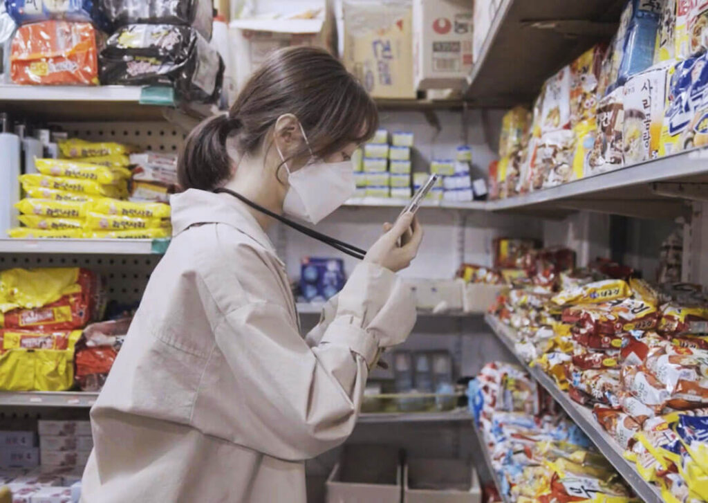 visually impaired women scanning supermarket products with dot go app